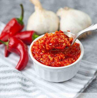 homemade Asian chili garlic sauce on the silver spoon