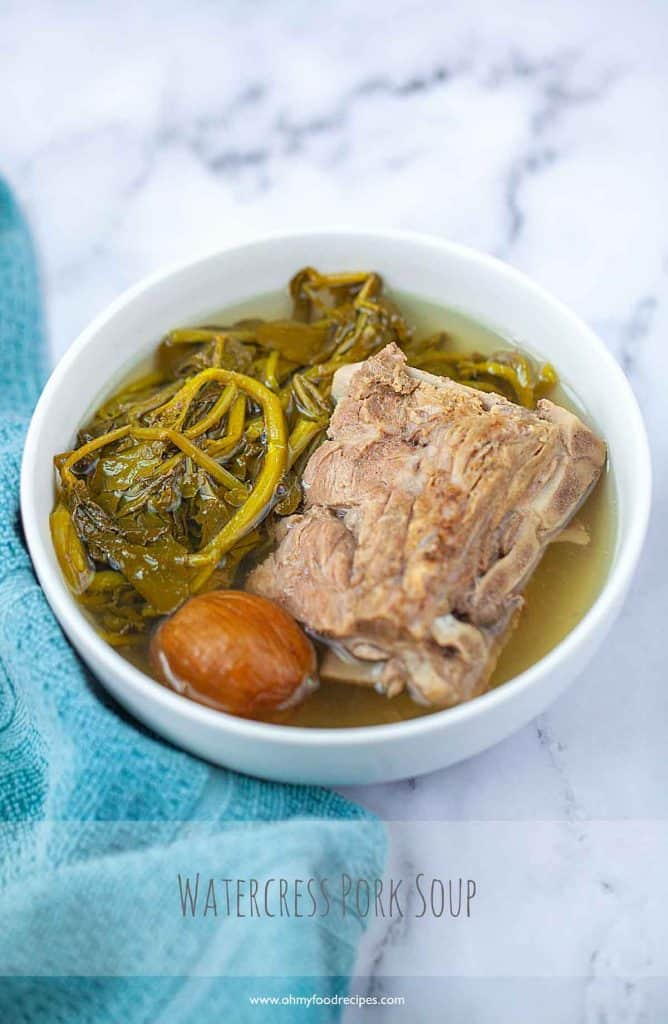 watercress pork soup Chinese with a blue towel