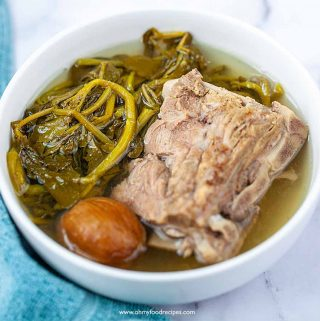 Chinese watercress pork bone soup with blue towel on the side