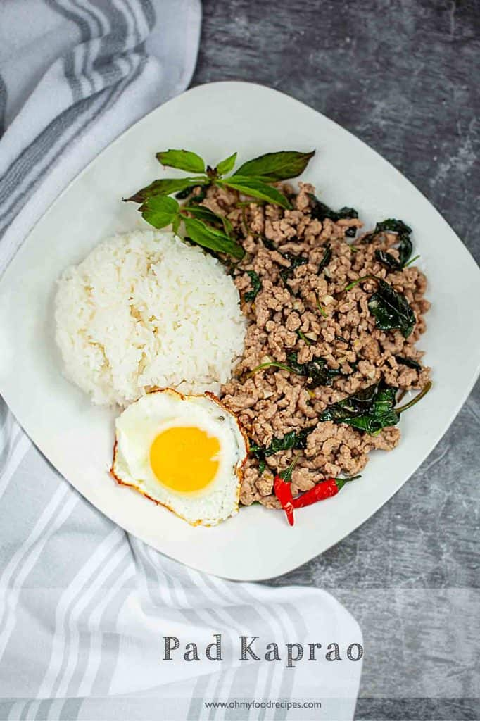 Thai pad ka pao on a white plate top view