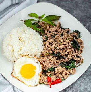 pad ka prao on a plate with rice and egg