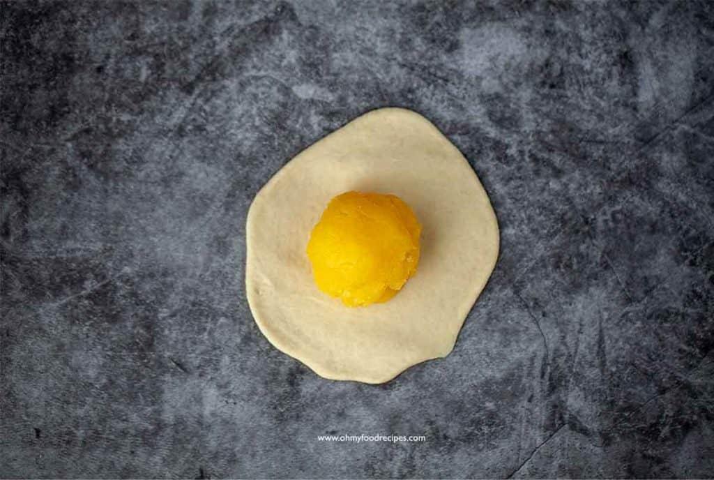 custard filling ball on the flatten dough