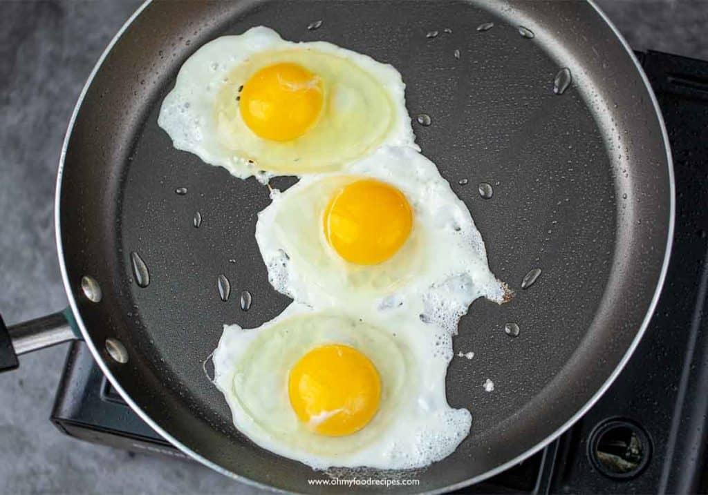 pan fried 3 eggs in a pan