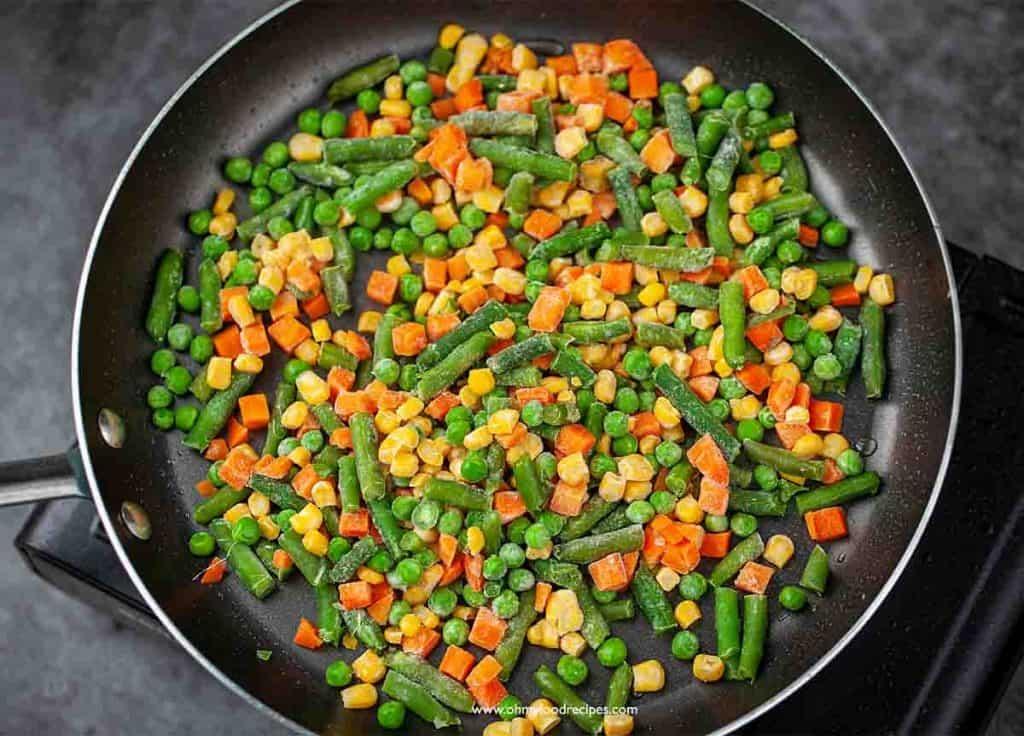stir fry frozen vegetables in a pan