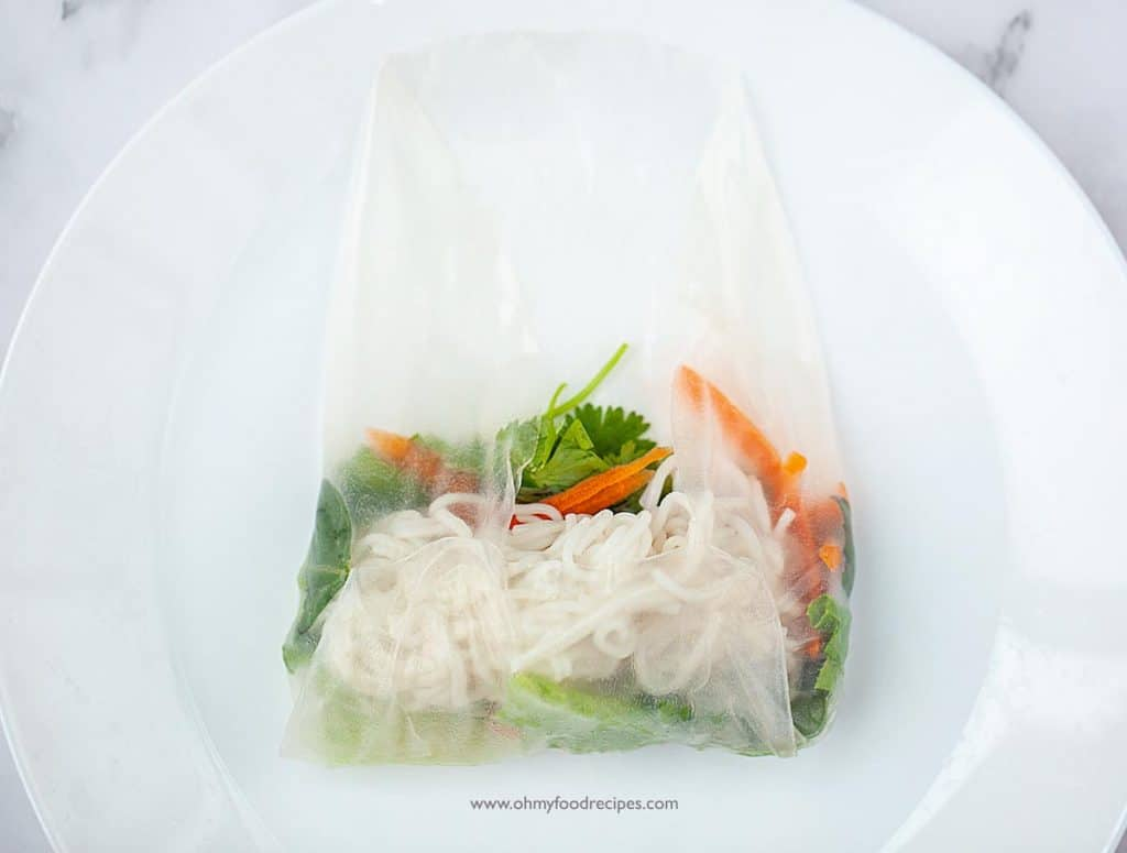 Shrimp Vietnamese spring roll rice paper folded the sides and bottom with the fillings