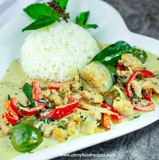 Thai green curry chicken with rice on a plate