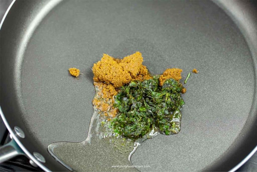 green curry paste and Thai basil paste with oil in the pan