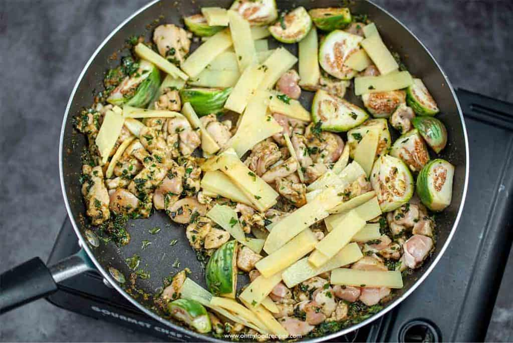 bamboo shoots stir fry with chicken Thai eggplants and green curry paste in the pan