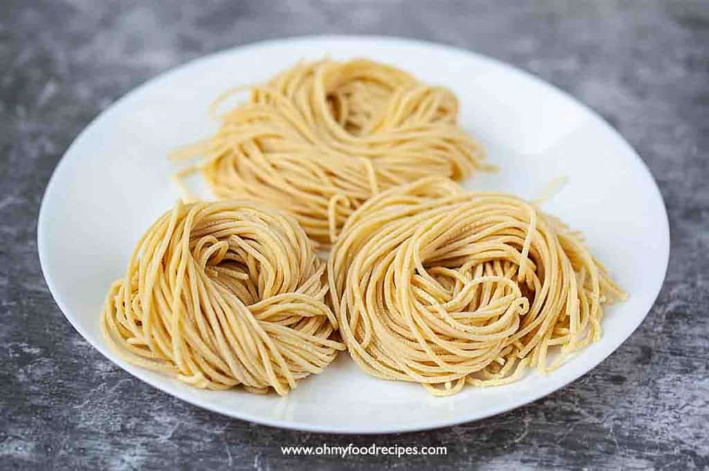 fresh homemade ramen noodles on the white plate