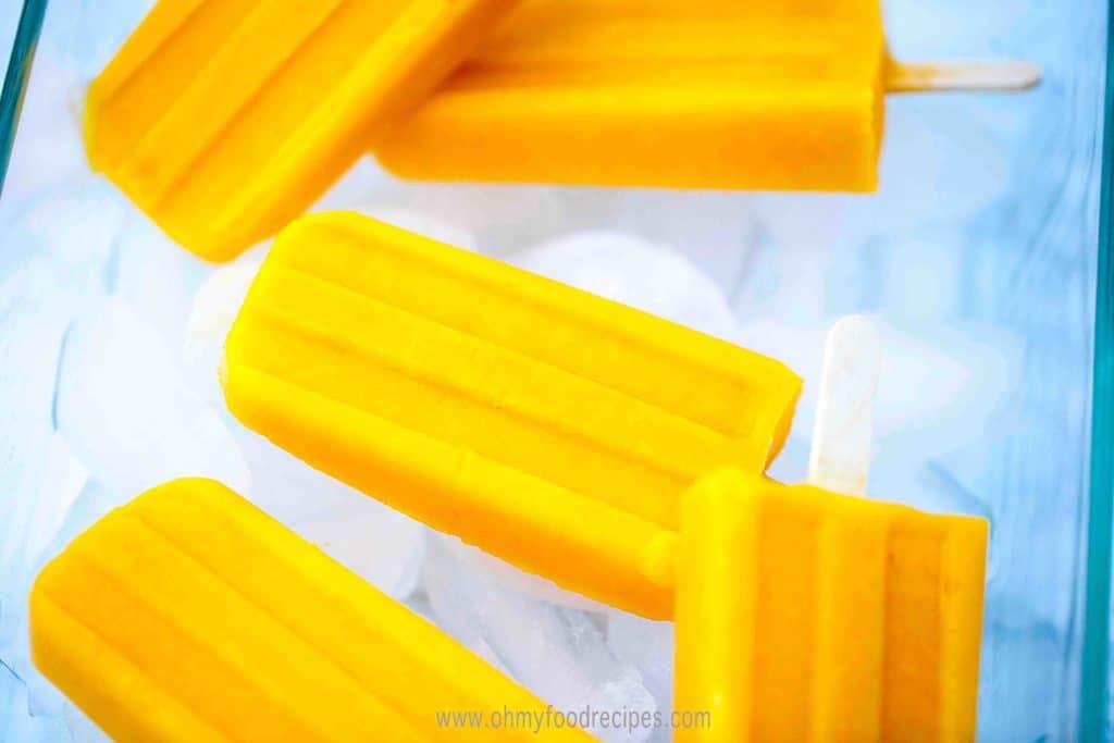 Homemade juicy mango popsicles