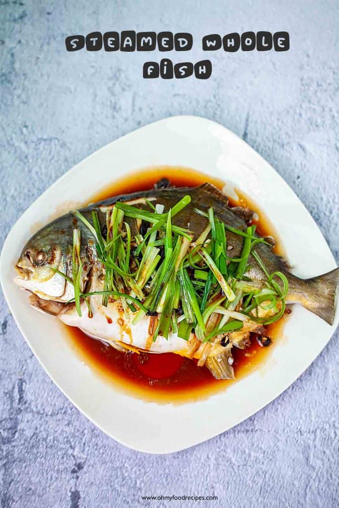steamed whole golden pomfret fish on a plate
