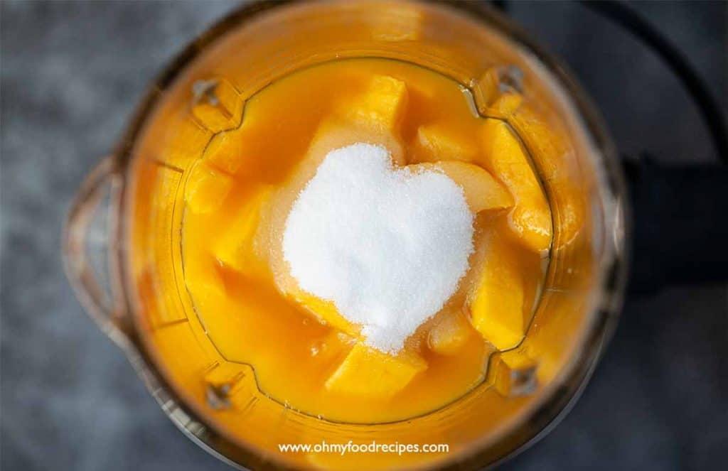 mango, mango juice and sugar in the blender