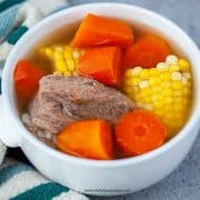 Chinese corn carrot pork soup in a white bowl