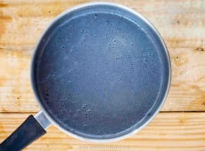 Black sesame soup boiling in a pot