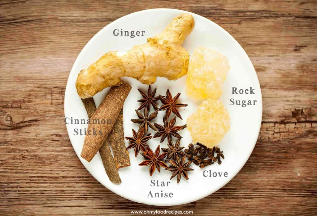 ginger cinnamon sticks star anise clove rock sugar on a plate