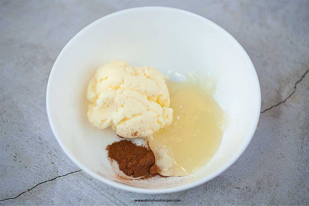 cinnamon powder honey and butter in a white bowl