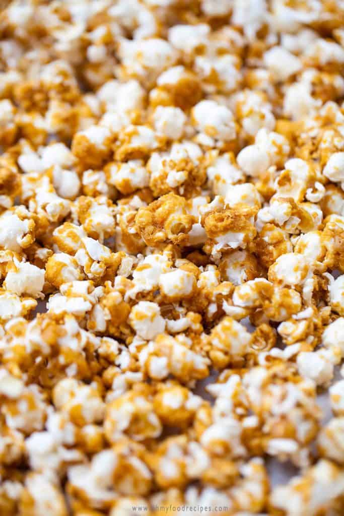 baked caramel popcorn on a cookie sheet