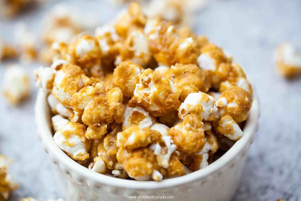 best baked homemade caramel popcorn in a bowl