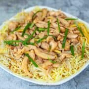 chicken yi mein noodles on the white square plate