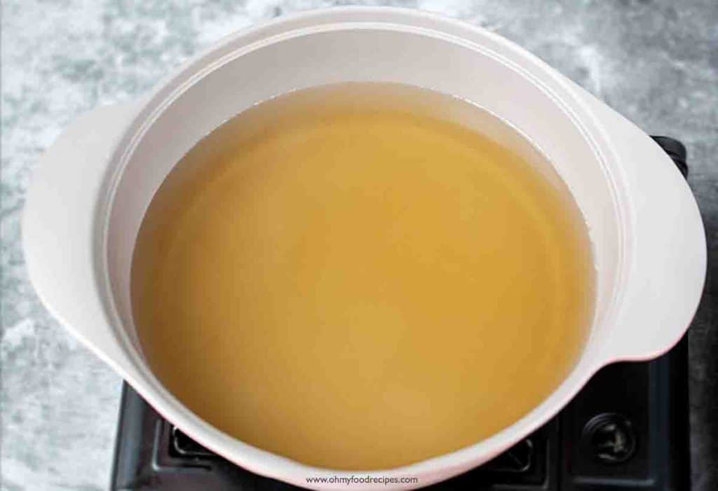 Chicken broth into the pot over the stove