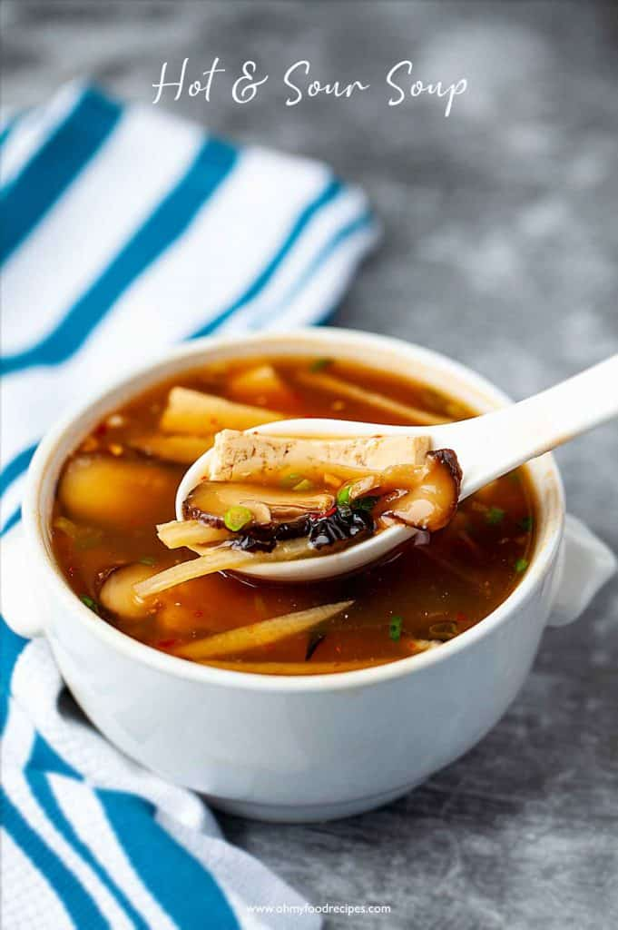 Chinese hot and sour soup on the spoon