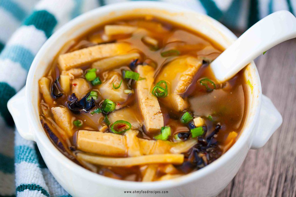hot sour soup in a bowl with a spoon