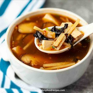 Authentic Chinese hot and sour soup on the spoon