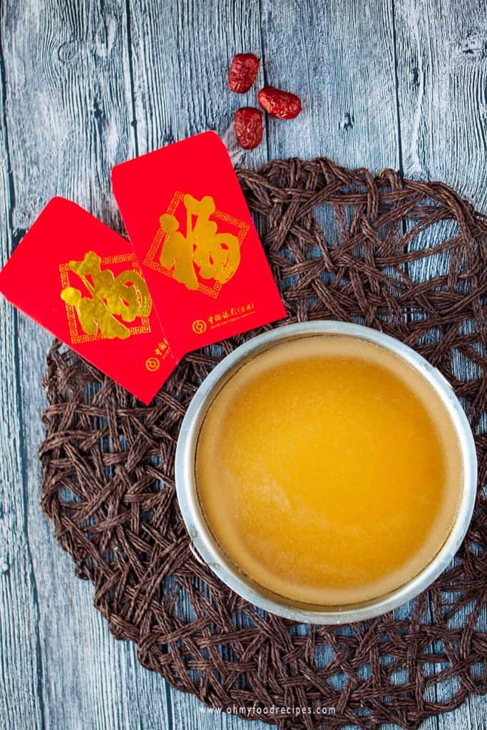 Chinese new year sweet rice cake with red pockets and dried jujube