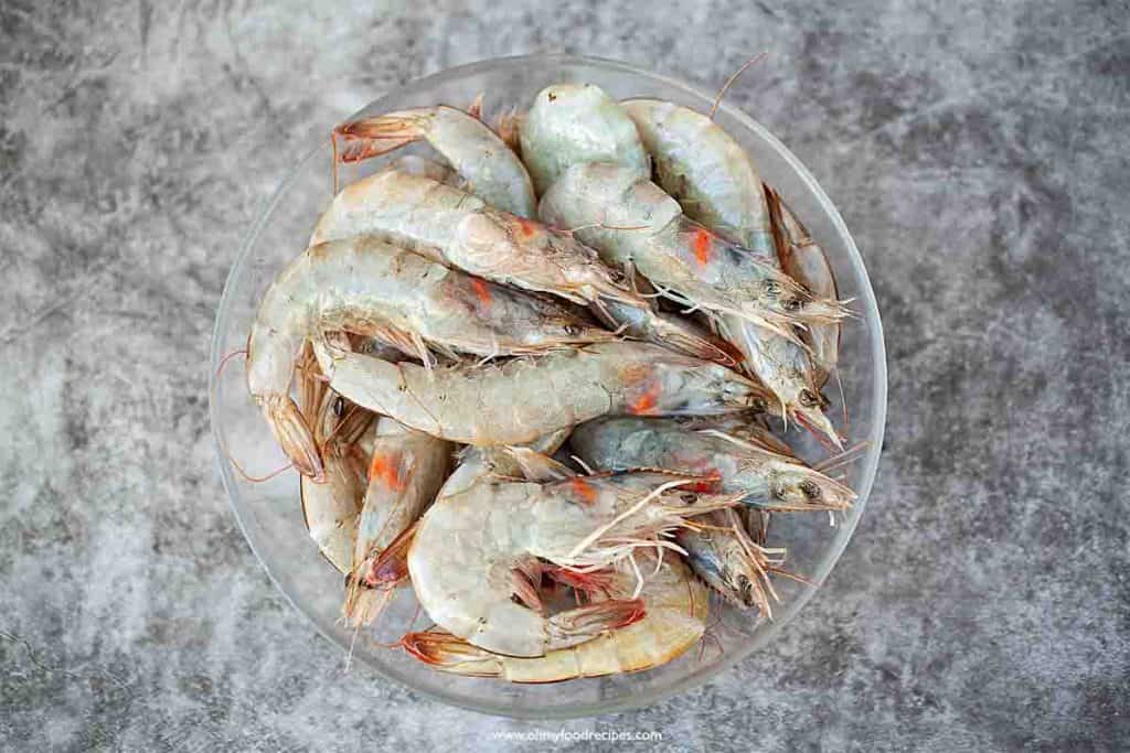 raw whole shrimp in the glass plate top view