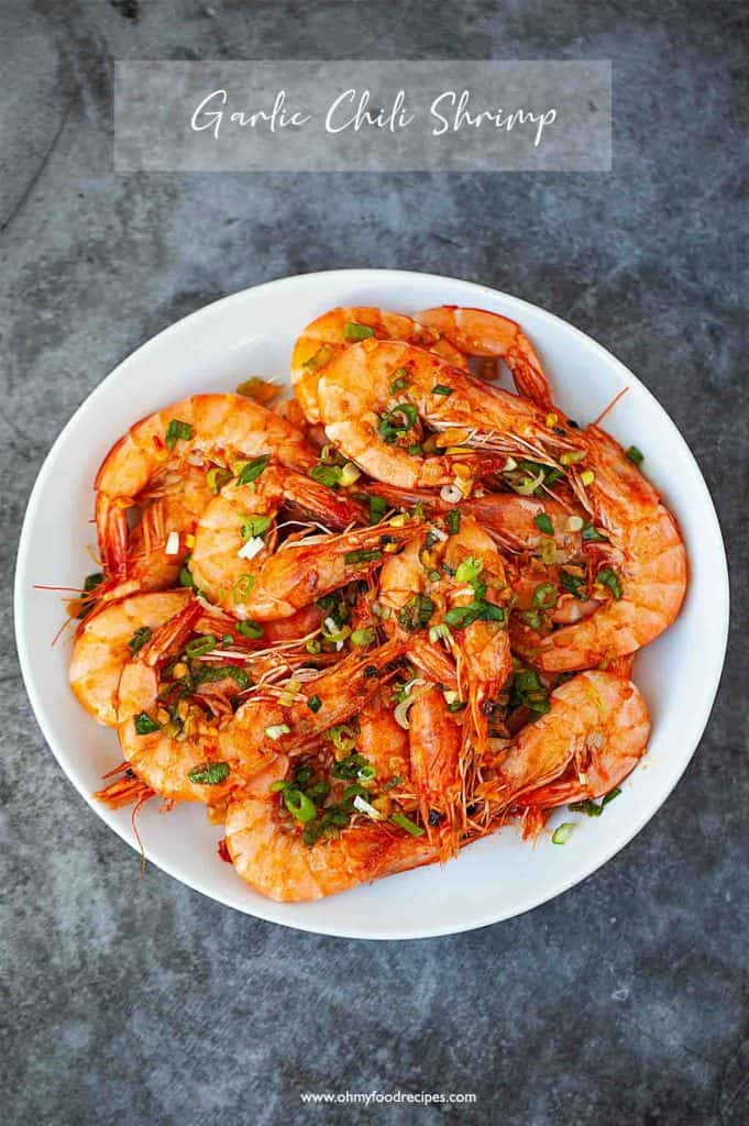 Chili garlic shrimp on a white plate  top view