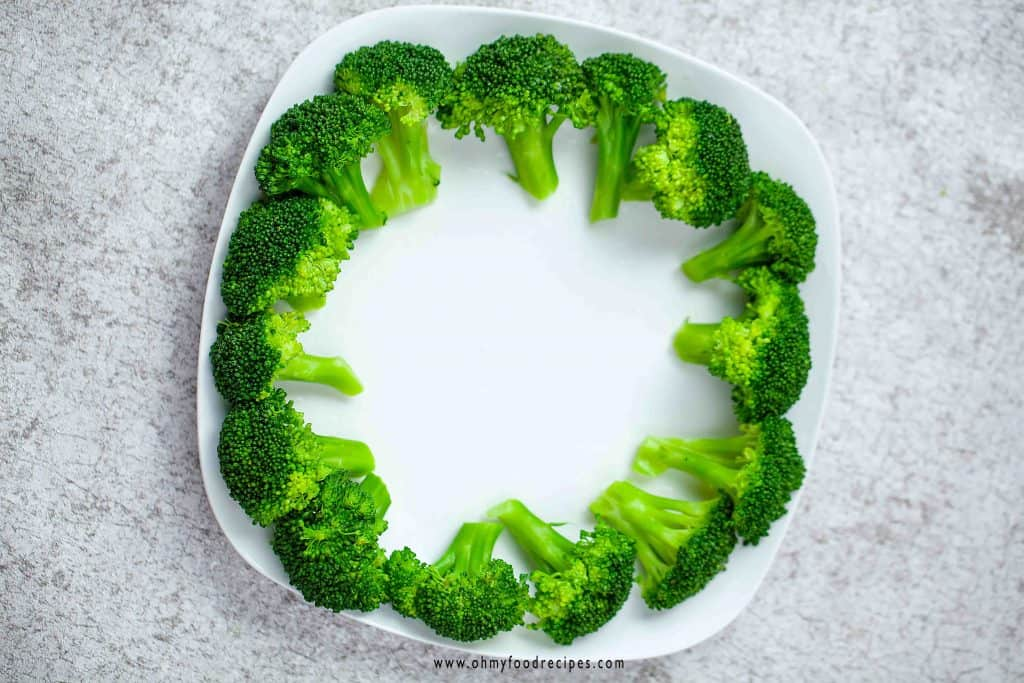 cooked broccoli lay around the plate
