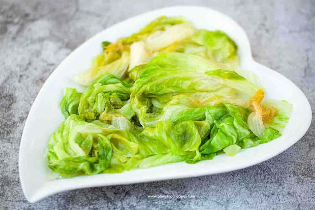 cooked lettuce on a white heart shaped plate