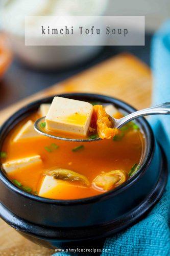 kimchi tofu soup on a silver spoon