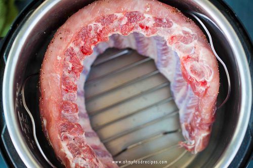 put the ribs into instant pot on a rack
