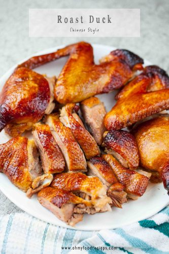 roast duck cut up on a white plate