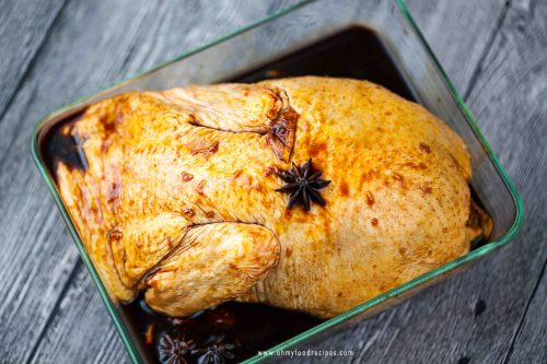 marinated whole duck in a glass container