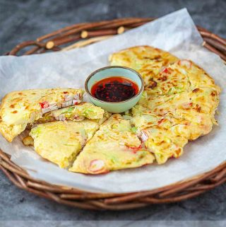 Chinese pancake cut up in the tray with chili oil sauce