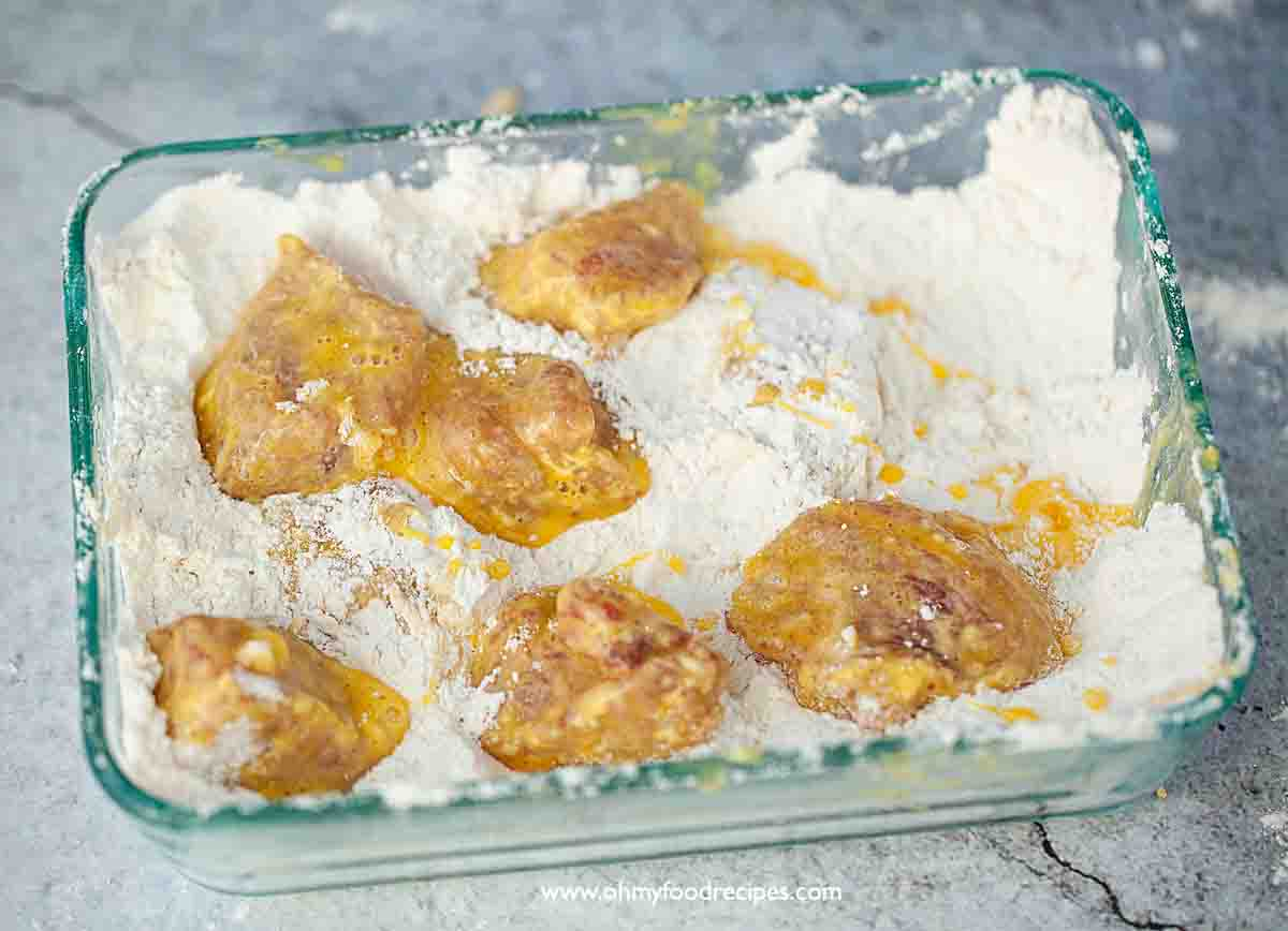 dip the egg batter pork into the flour mixture