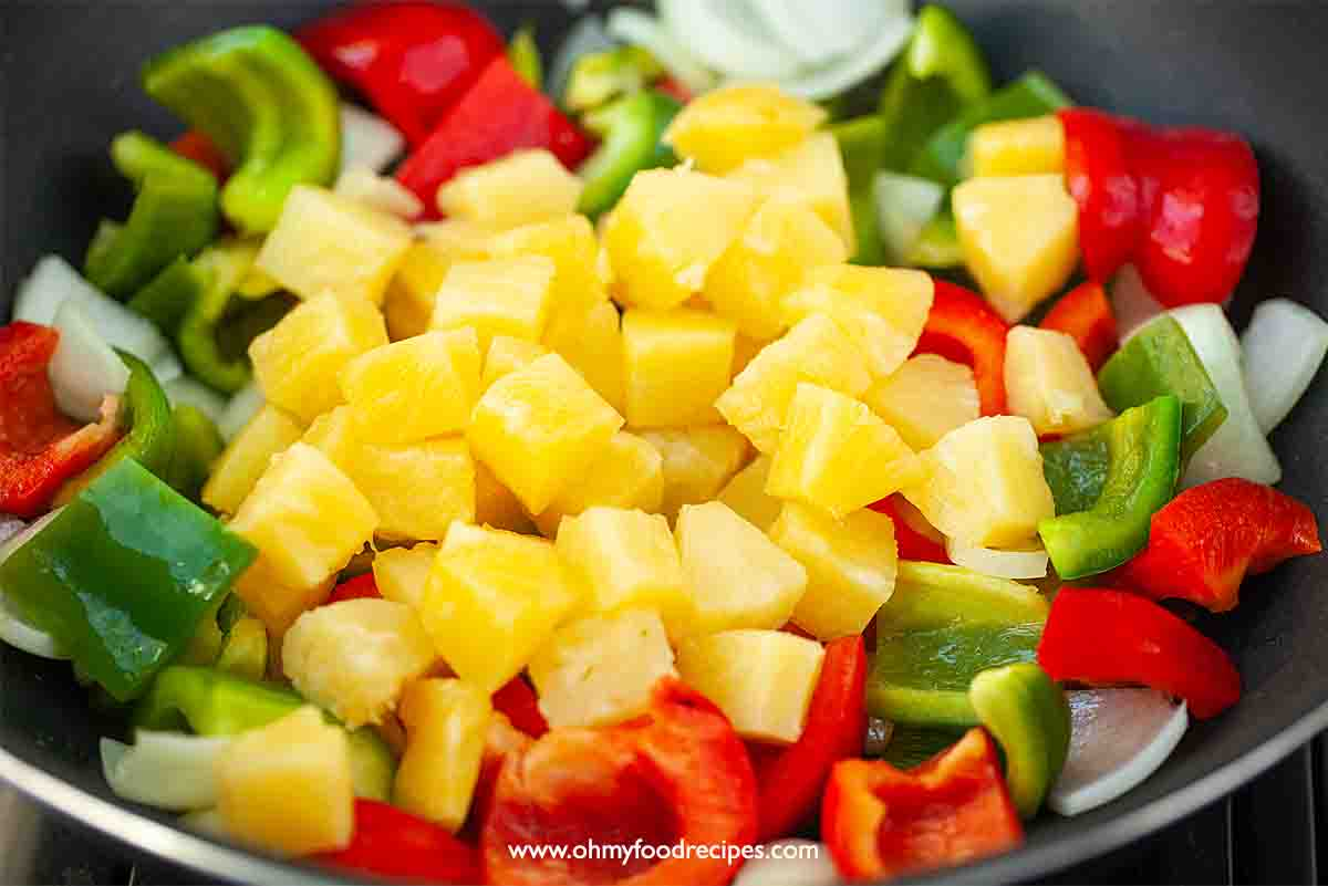 Pineapple stir fry with vegetables in the wok