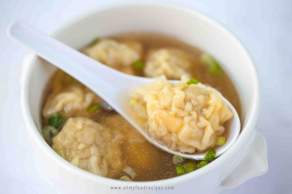 wonton on a spoon in wonton soup