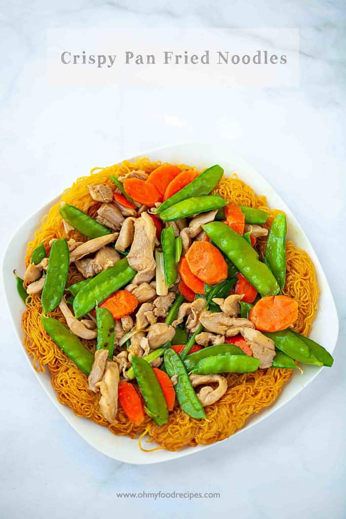 crispy pan fried fresh egg noodles with chicken carrot and snow peas