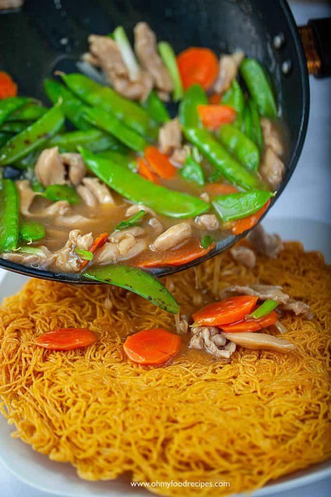 pour sauce over crispy pan fried noodles