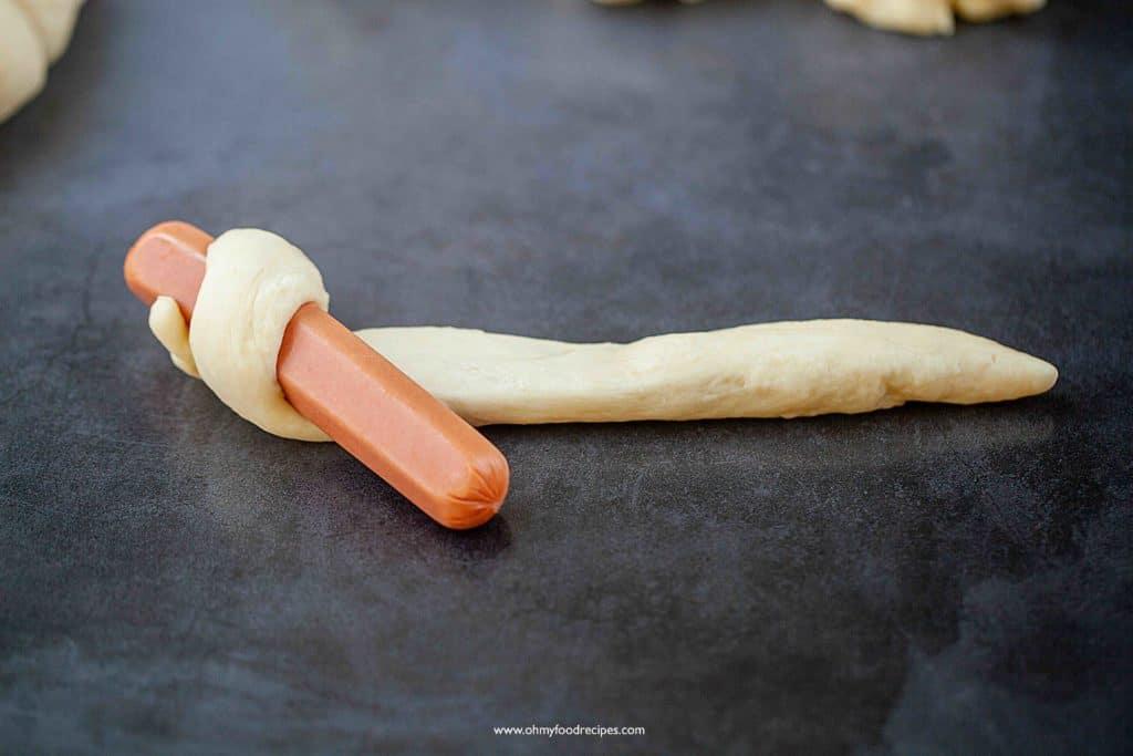 wrap dough around hot dog