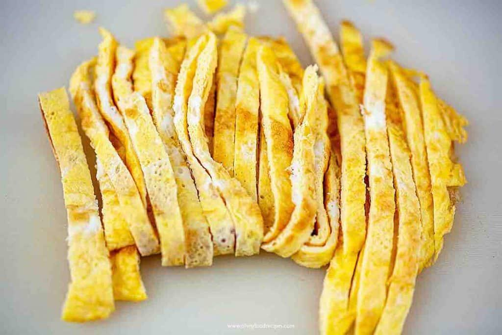 cut pan fried eggs into strips