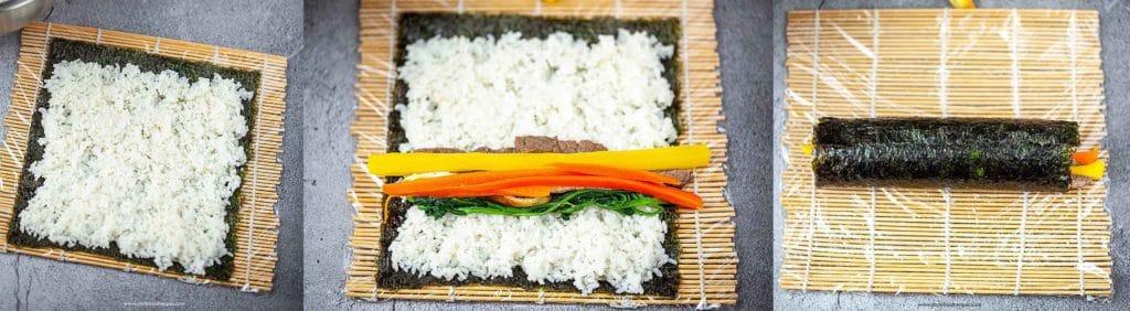 rice and fillings on nori rolling kimbpa/gimbap with bamboo sushi mat