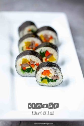 sliced korean kimbap sushi roll on a long white plate