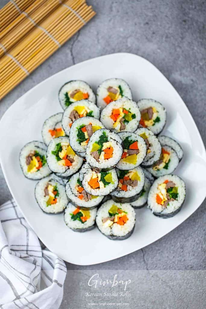 top view sliced kimbap or gimbap stack up on a white plate