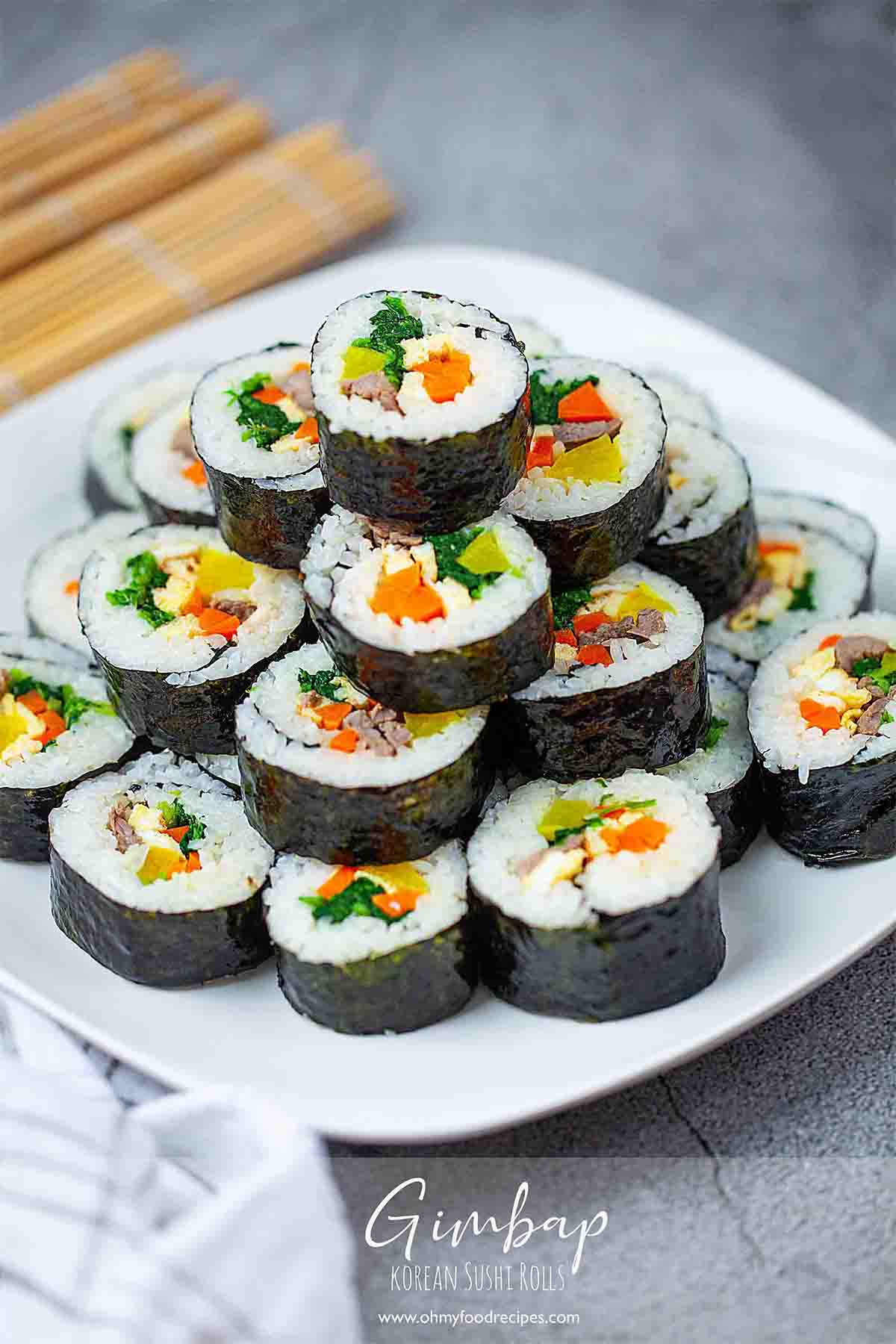 Korean sushi roll Kimbap or gimbap stack up on the white plate vertical