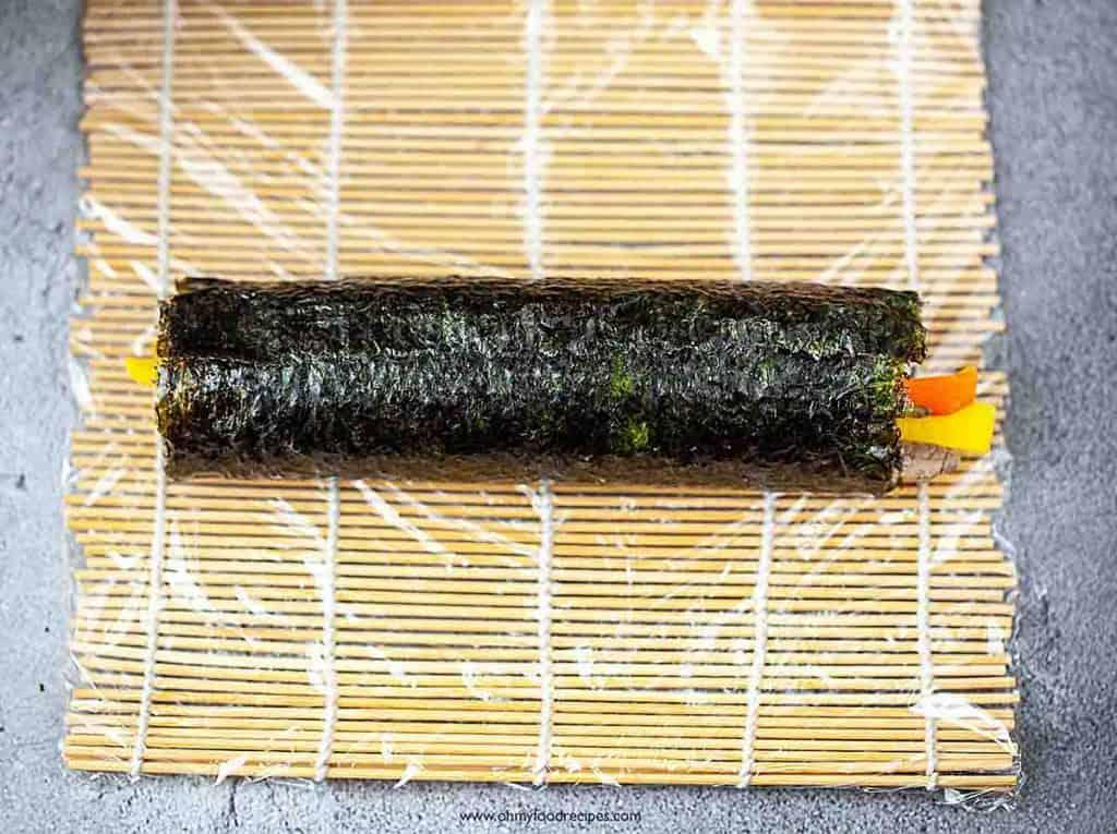kimbap or gimbap Korean sushi rolls on the bamboo mat