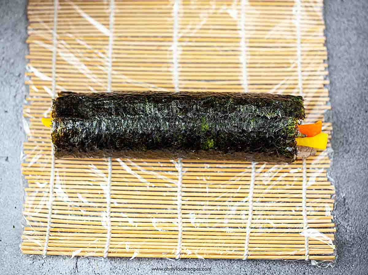 kimbap or gimbap Korean sushi roll on the bamboo mat